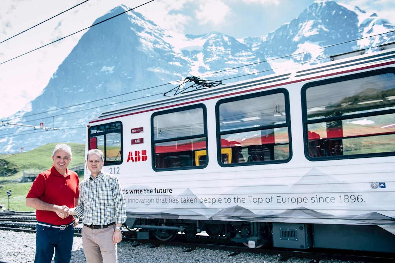 Urs Kessler, CEO of Jungfraubahnen, and Remo Lütolf, Managing Director of ABB Switzerland, in front of the new ABB branded Jungfrau Railways train