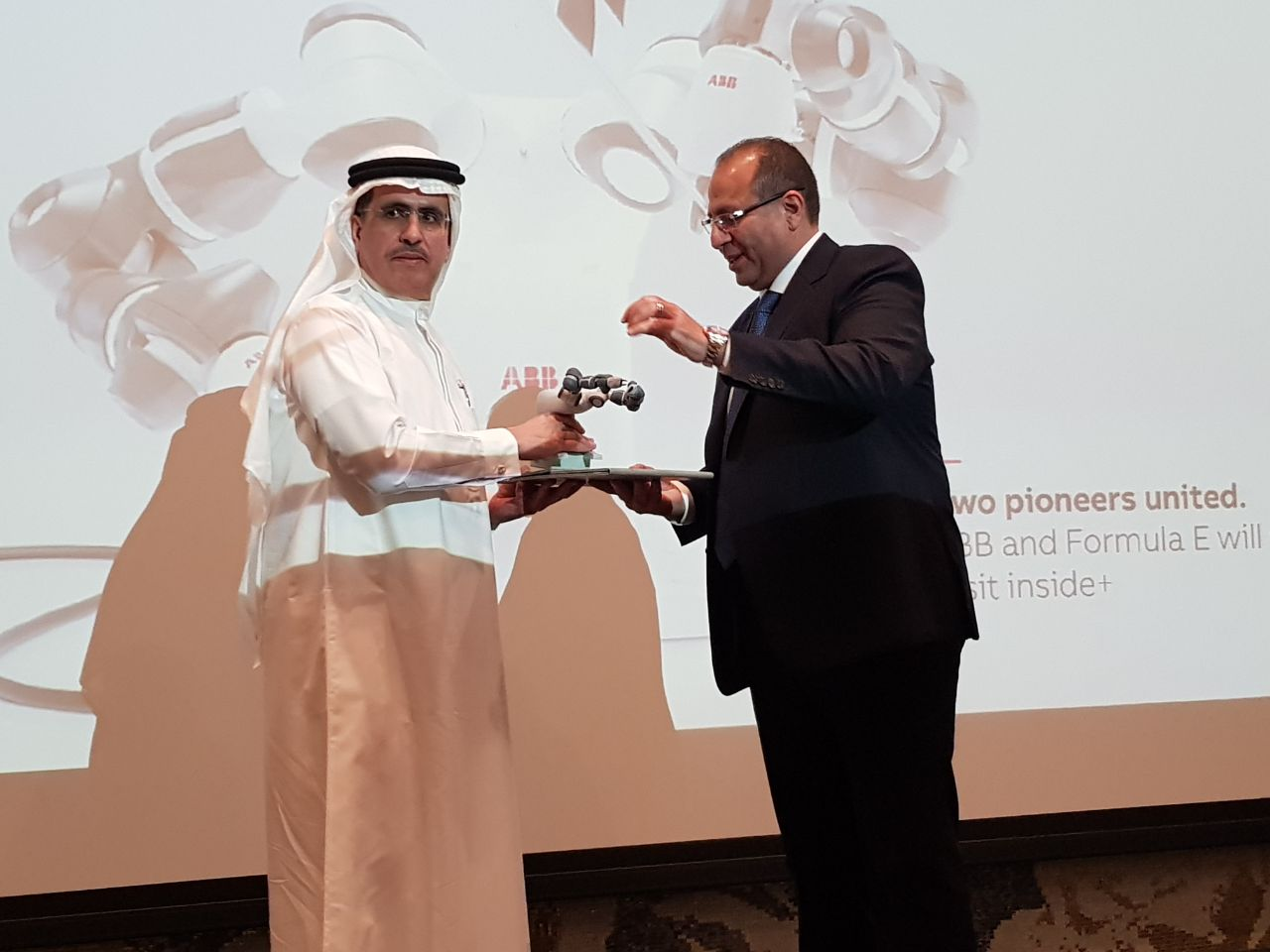Mostafa Al Guezeri presents HE Saeed Al Tayer a token of appreciation